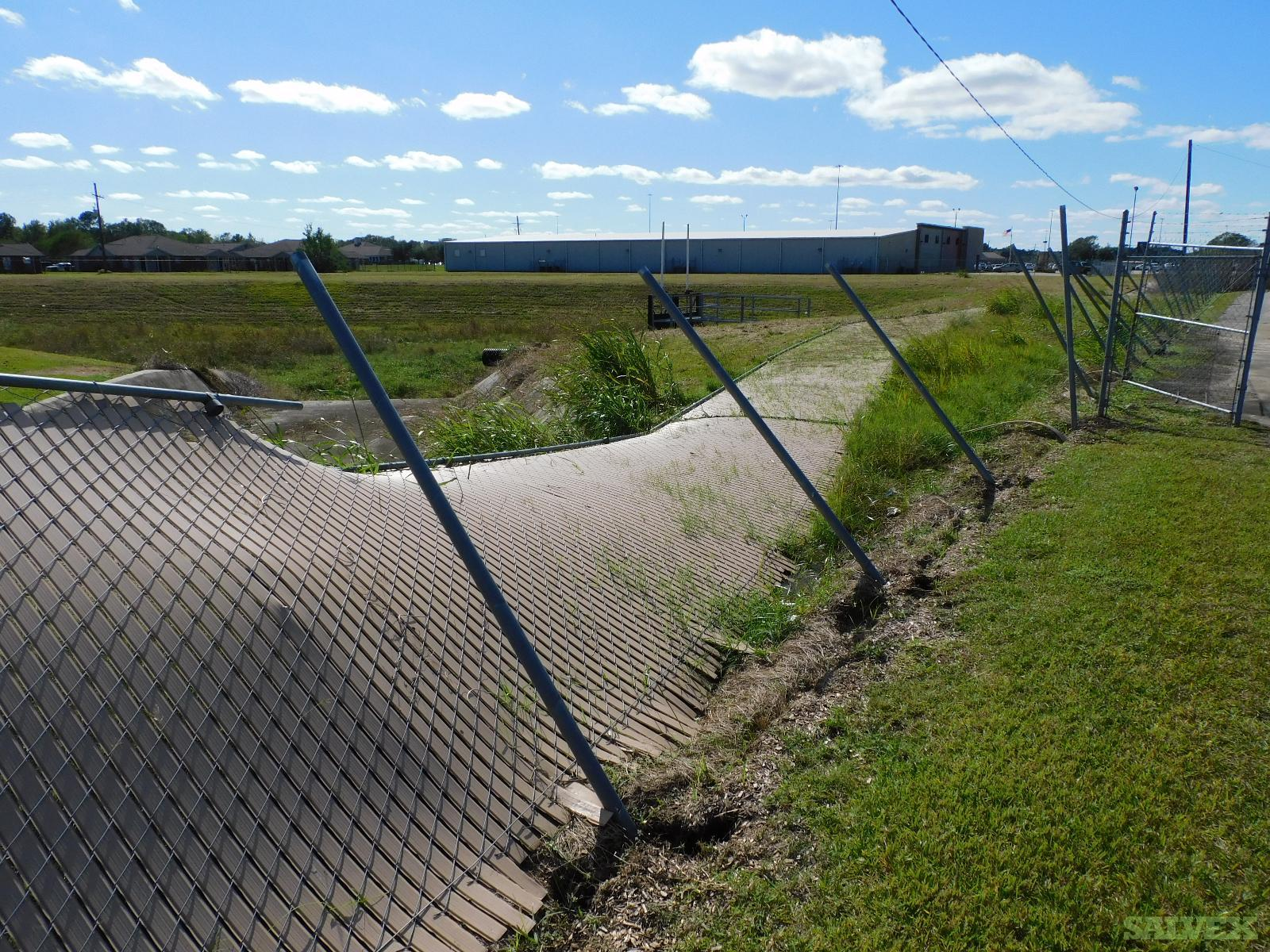 High Chain Link Fencing and Crossmembers 8-9 (400 LF)